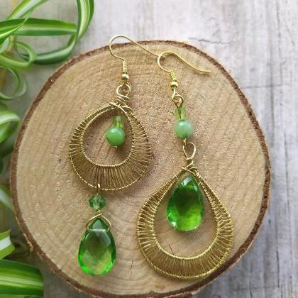 Mismatched green earrings, Asymmetr..